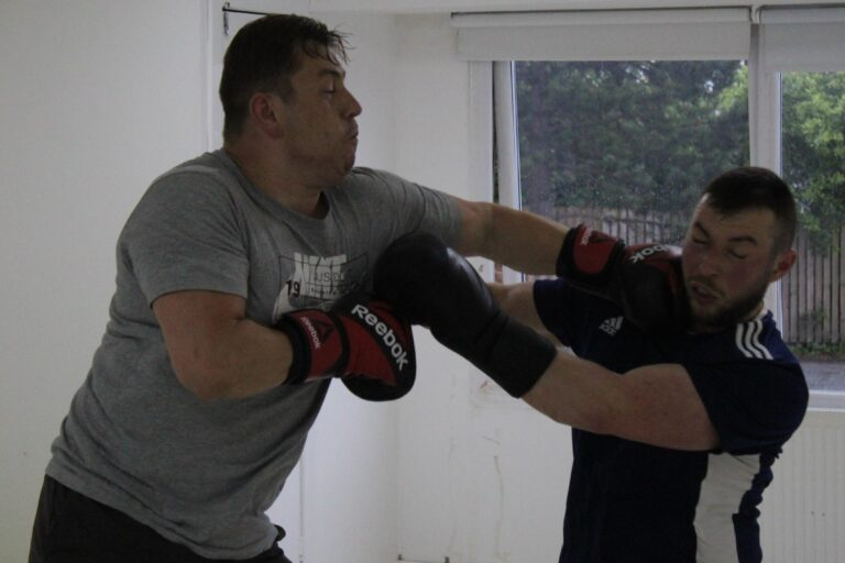 boxer landing a hit to head on the opponent