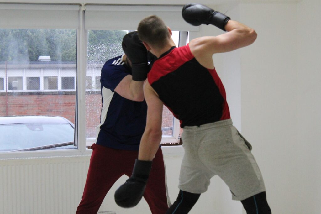 Boxer Mike throwing a body shot
