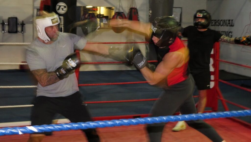 Mike Slowak throwing boxing combinations during sparring.