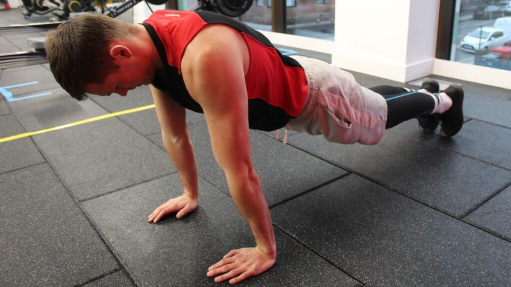 Mike back up to the plank position during the third step of performing the standard proper pushup form.