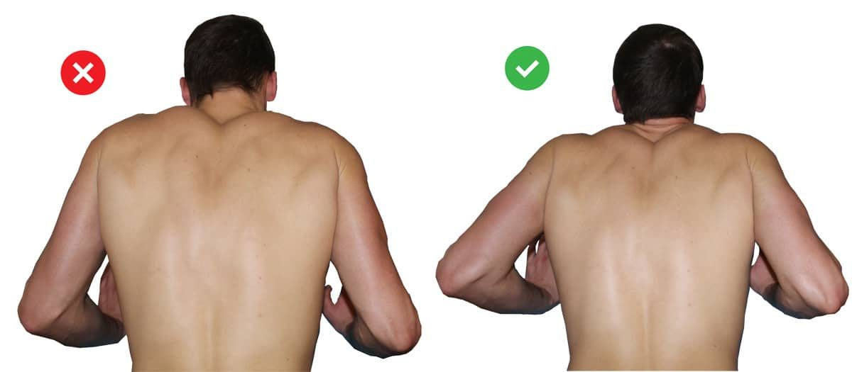Proper pushup form: demonstration of the mistake in a side by side comparison of not squeezing the shoulders.